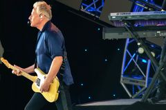 stock image of  graham russell   from air supply, singing beautiful melody at epcot in walt disney world 7