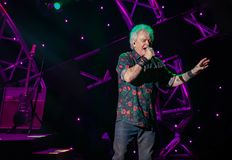 stock image of  russell hitchcock from air supply, singing beautiful melody at epcot in walt disney world 25