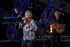 stock image of  russell hitchcock  from air supply, singing beautiful melody at epcot in walt disney world 2