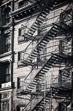 stock image of  outside metal fire escape stairs, new york city black and white
