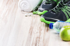 stock image of  pair of sport shoes and fitness accessories
