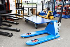 stock image of  pallet jacks in store