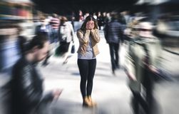 stock image of  panic attack in public place. woman having panic disorder.