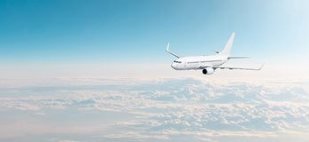stock image of  passenger aircraft cloudscape with white airplane is flying in the evening sky overcast, panorama view.