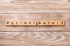 stock image of  patient safety word written on wood block. patient safety text on wooden table for your desing, concept