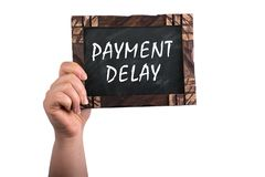 stock image of  payment delay on chalkboard