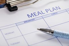 stock image of  pen with meal plan form
