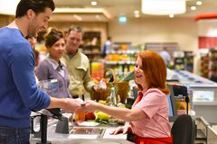 stock image of  people shopping for food in the supermarket - checkout paying