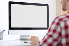 stock image of  person front of computer monitor
