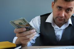 stock image of  personal loan concept. man offers money in the office