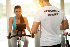 stock image of  personal trainer at the gym