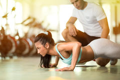 stock image of  personal trainer with his client