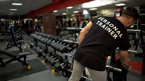 stock image of  personal trainer preparing training site for his clients gym, sport profession
