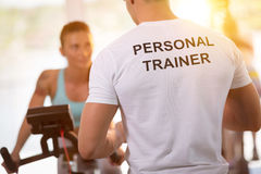 stock image of  personal trainer on training with client