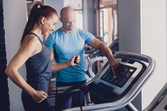 stock image of  personal training with a trainer on a treadmill