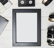 stock image of  photo frame surrounding by all the entertainment technology devices