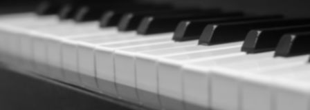 stock image of  piano keys close-up, side view of a musical instrument