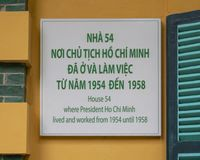 stock image of  information plaque for house 54 where president ho chi minh lived and worked from 1954 to 1958
