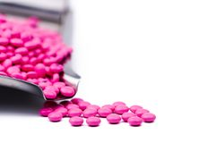 stock image of  pile of pink round sugar coated tablets pills on drug tray with copy space. pills for treatment anti anxiety, antidepressant a