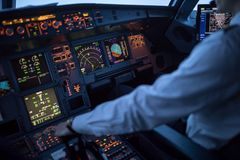 stock image of  pilot`s hand accelerating on the throttle in a commercial airlineri