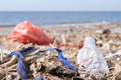stock image of  plastic waste and trash on sandy beach. environmental pollution problem concept.