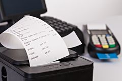 stock image of  point of sale system for retail with paper shoppin