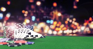 stock image of  poker flush royal background with casino chips on green table