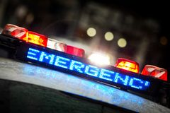 stock image of  police emergency lights with warning text