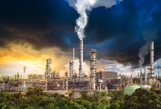 stock image of  pollution from oil refinery