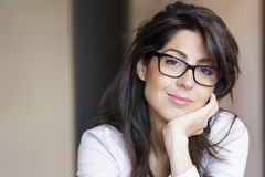 stock image of  portrait of beautiful young woman with modern eyeglasses