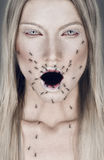 stock image of  portrait of blond woman with open mouth and ants