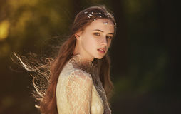 stock image of  portrait of a cute dreamy girl wearing retro blouse and skirt outdoors. soft vintage toning.