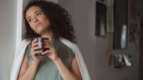 stock image of  portrait of pensive woman drinking coffee or tea at home.