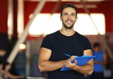 stock image of  portrait of personal trainer holding clipboard