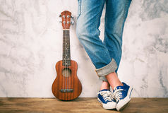 stock image of  posing with ukulele.