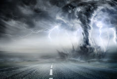 stock image of  powerful tornado on road