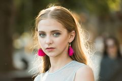 stock image of  pretty girl with fashionable hair and earrings. beauty and fashion look of vogue model. summer fashion woman. perfect