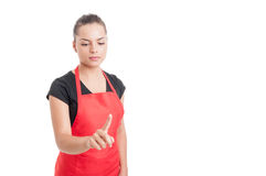 stock image of  pretty hypermarket employee touching or pointing to something