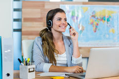 stock image of  pretty travel agent speaking to customer