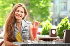 stock image of  pretty woman drinking tasty smoothie