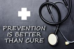 stock image of  prevention is better than cure text on chalkboard near medical object and symbols