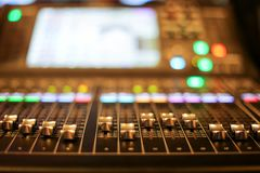 stock image of  professional audio mixer and professional headphones in the recording studio. sound mixing desk. sound mastering for radio and tv