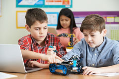 stock image of  pupils in science lesson studying robotics