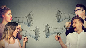 stock image of  quarrel between women and men