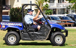 stock image of  queensland police patrolling beach in 4wheel drive