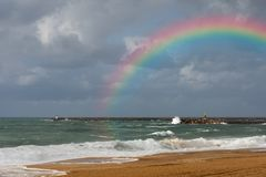 stock image of  rainbow on the beach of anglet after the storm
