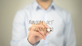 stock image of  random act of kindness , man writing on transparent screen