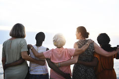 stock image of  rear view of diverse senior women standing together at the beach