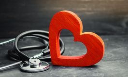 stock image of  red heart and stethoscope. the concept of medicine and health insurance, family, life. ambulance. cardiology healthcare.