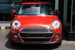 stock image of  a red painted small luxury car parked on display